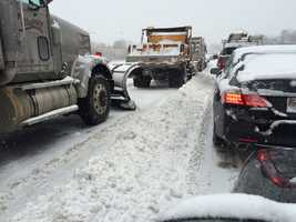 Traffic at a standstill on the Beltway at I-83 southbound, where plows are stuck in traffic, too.