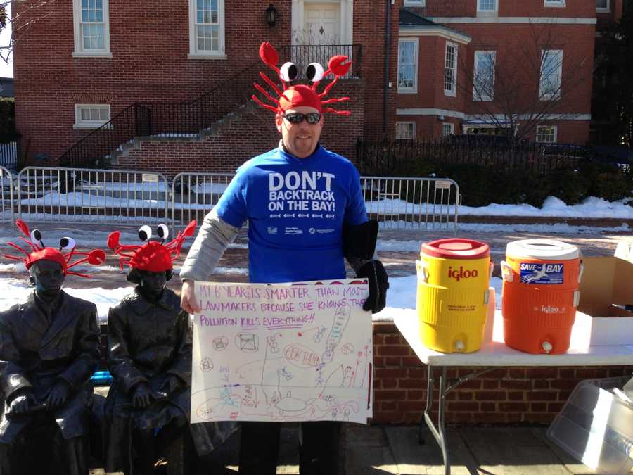 """Demonstrators wore blue t-shirts and crab hats. They handed out crab mallets with a tag saying """"Don't Backtrack on the Bay,"""" the main theme of the event."""