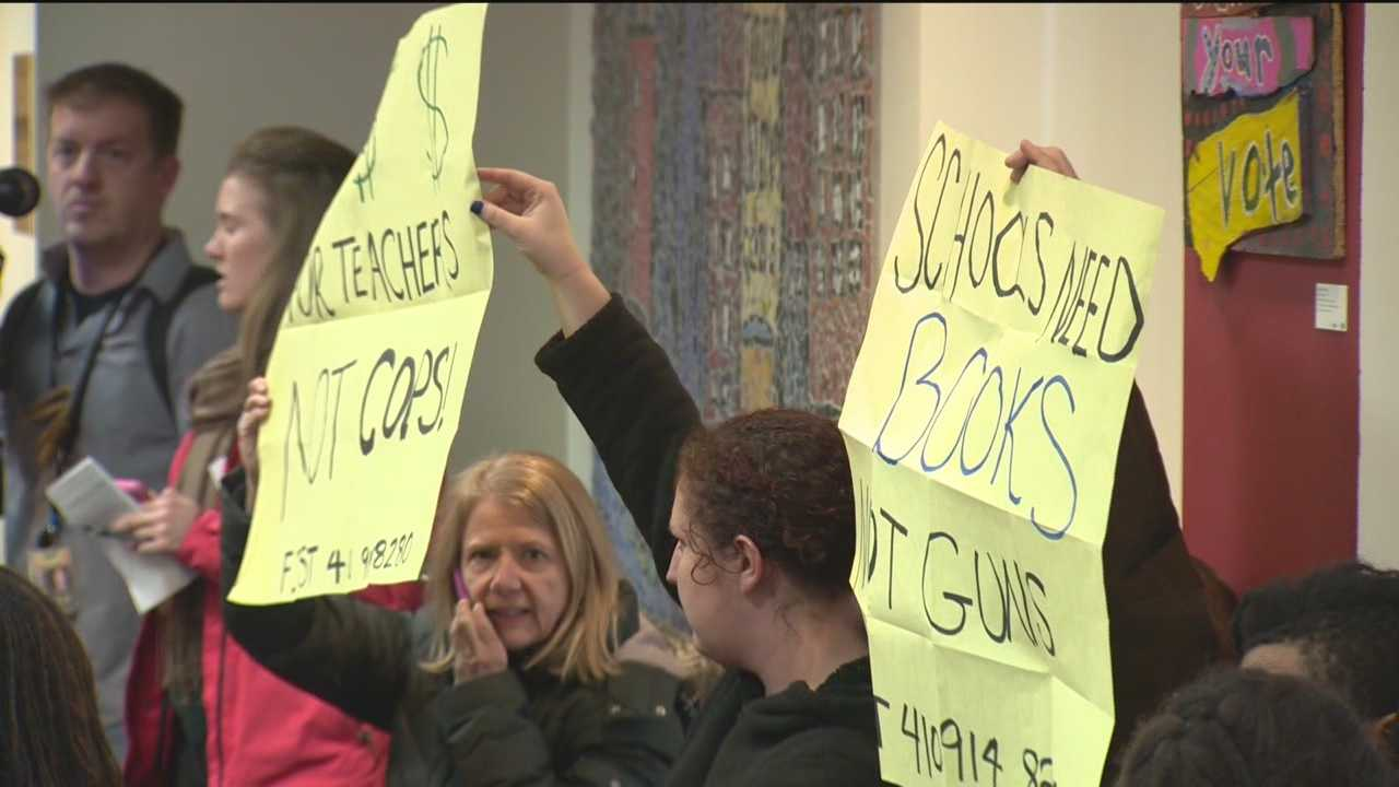 Those on both sides of a plan to arm Baltimore City school police officers inside of schools packed a public forum Tuesday night to address their concerns.