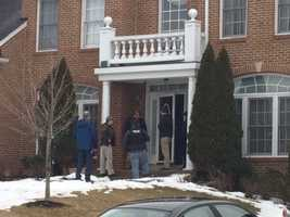 Police search the Beltsville home of the suspect highway shooter.