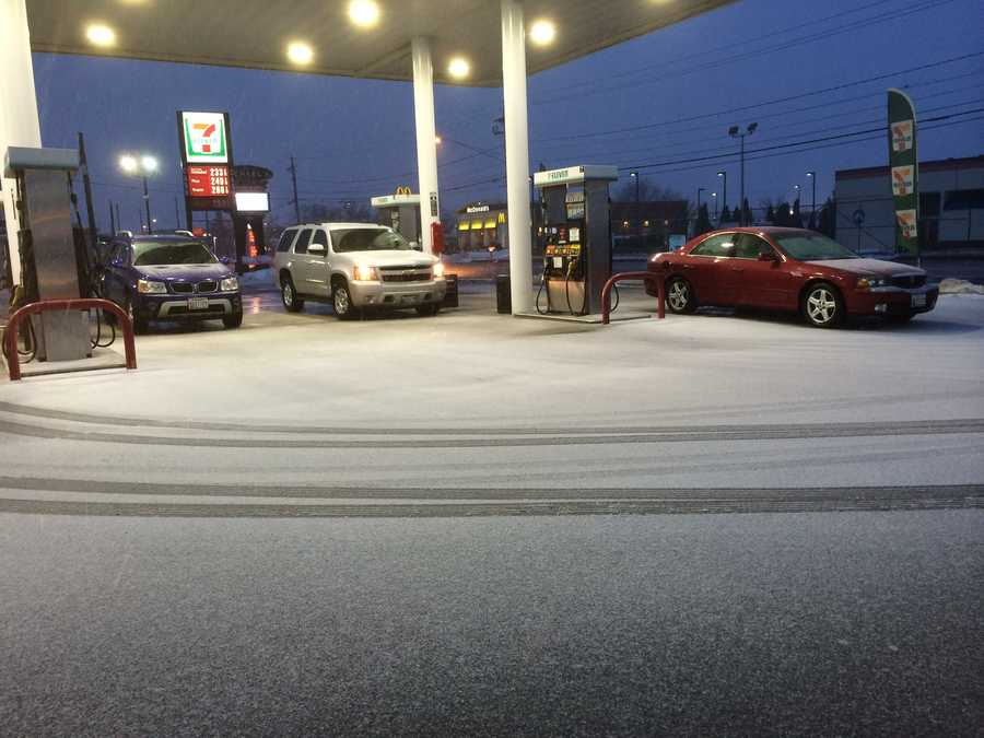 Wet snow and sleet sticking to the pavement at the 7-Eleven on York Road in Timonium at 6:30 a.m.