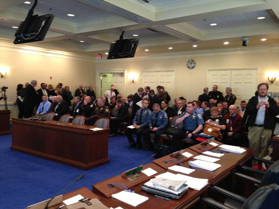 Members of law enforcement pack the judiciary committee room for the police accountability hearing.