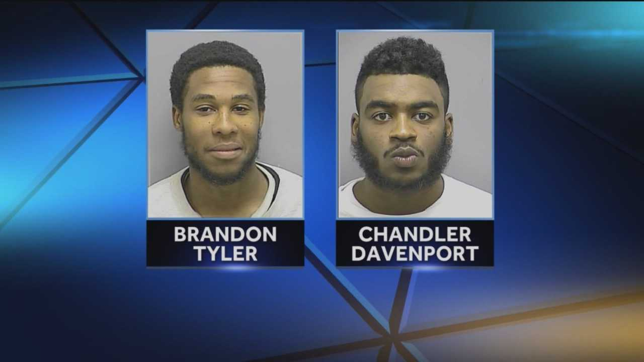 Police have arrested and charged two men in the shootings of two teenagers outside Frederick High School in February.