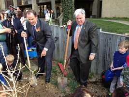 Gov. Hogan plants tree in the monarch butterfly habitat during an Earth Day event.