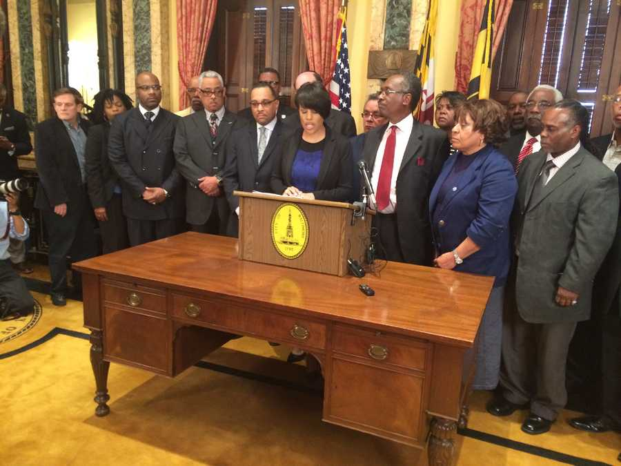 Baltimore Mayor Stephanie Rawlings-Blake holds a press conference with faith leaders to encourage peaceful demonstrations.