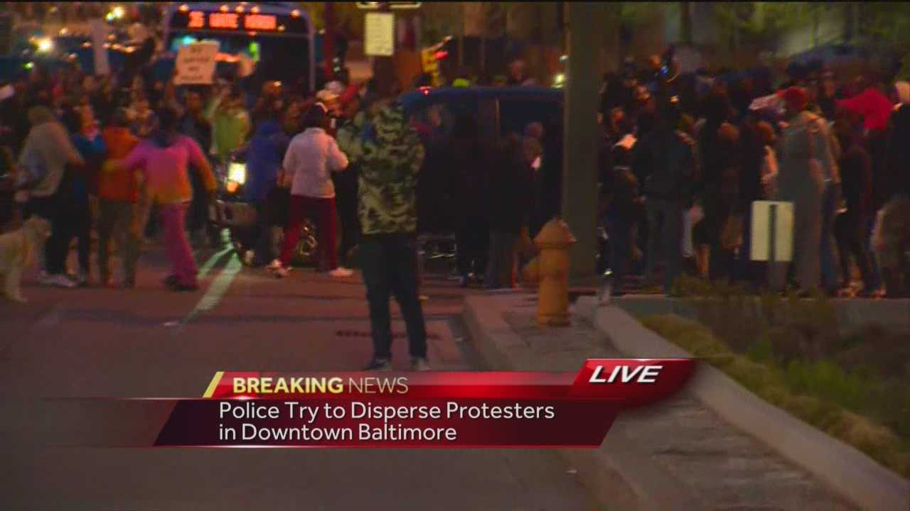 A pickup truck plows its way through an area where protesters were demonstrating at Pratt and Light streets.