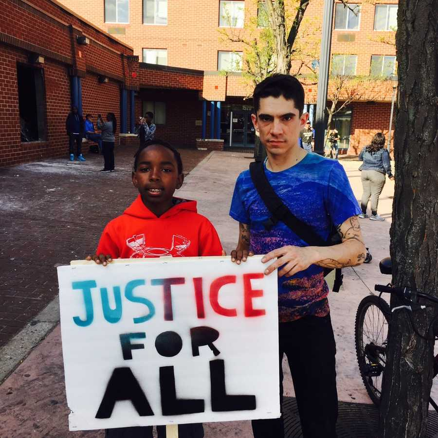 Kids with 'Justice for All' sign