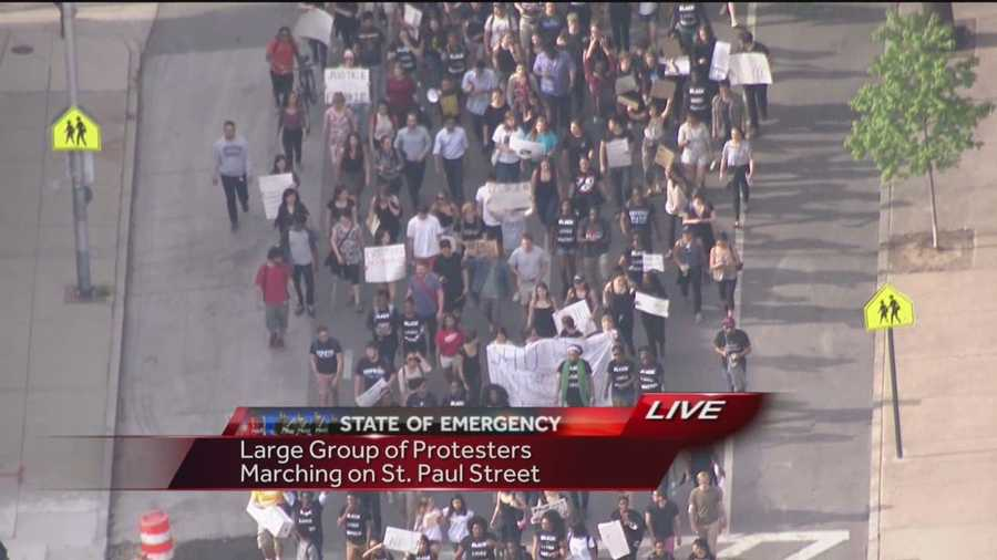 A large group of students march from Johns Hopkins University to Penn Station to meet with another group of students to continue on to City Hall.
