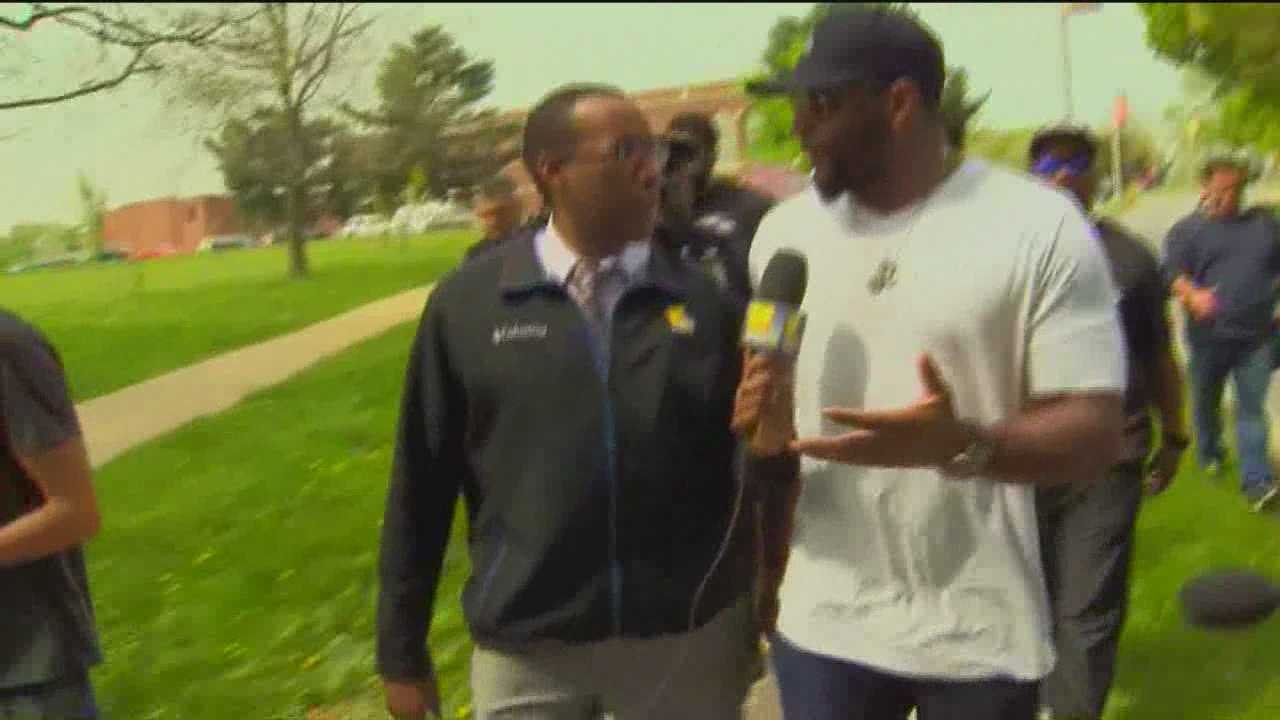More than 50 Baltimore Ravens players, Coach John Harbaugh and Ray Lewis spend Thursday morning in west Baltimore making a special delivery.