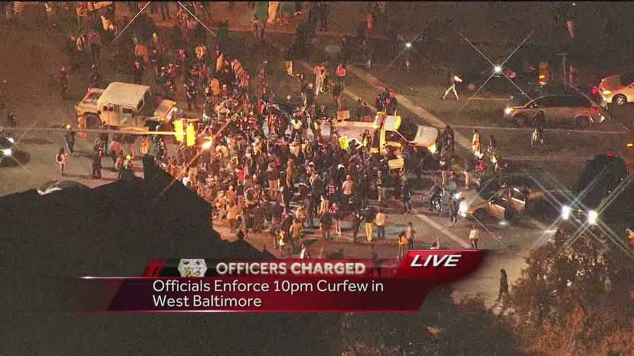 Police make arrests after the curfew takes effect Friday night and protesters remain in the streets