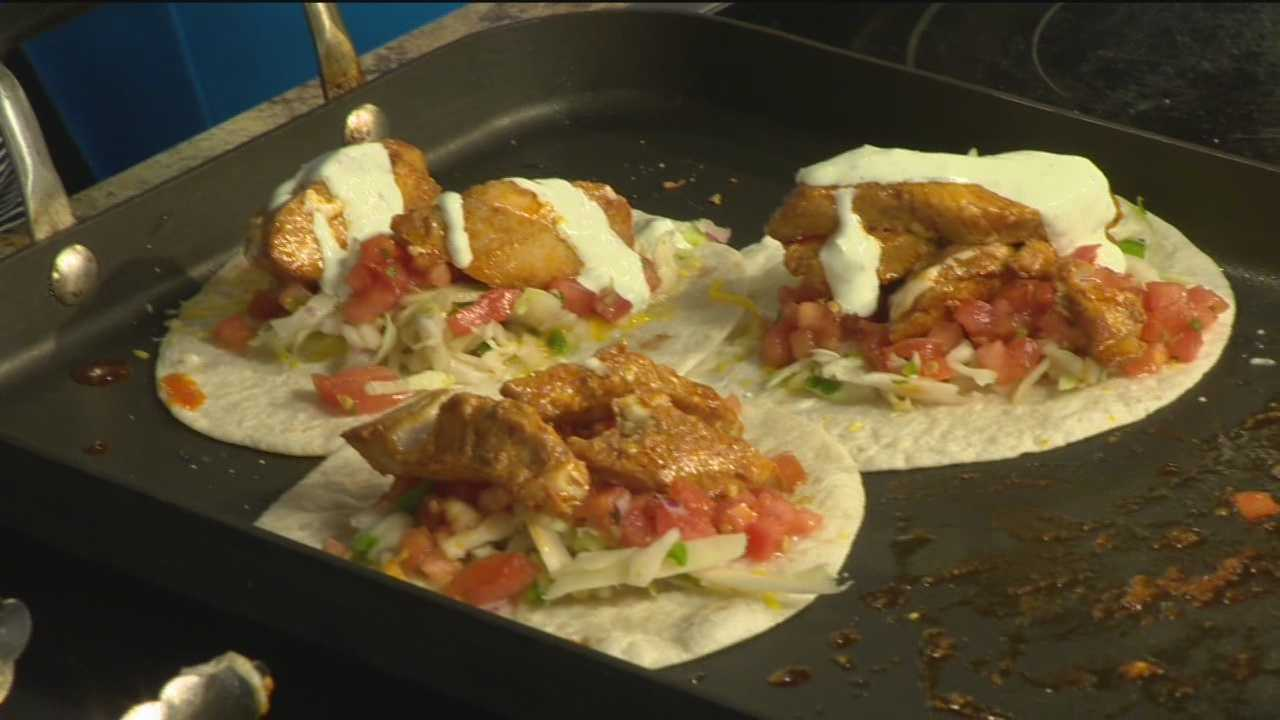 Chris Marquis and Willy Dey from Woody's Rum Bar & Island grille make fish tacos.