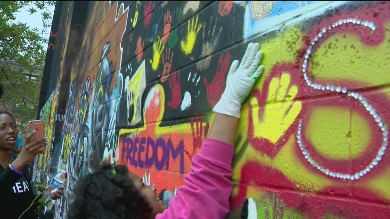 A community converges to spread art in an attempt to heal Baltimore after unrest over the death of Freddie Gray.