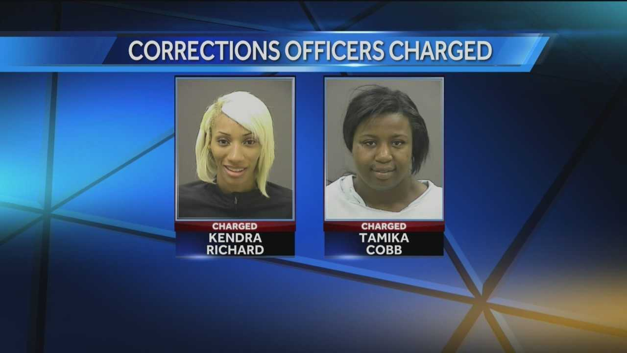 Corrections officers charged