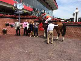 Jockey Trevor McCarthy wins the first race on Black-Eyed Susan Day.