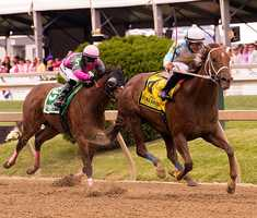 Four weeks after winning her debut at Pimlico Race Course, Triple R Stables' Galiana powered past front-running favorite Lady Sabelia in the stretch Friday for a 2 3/4-length victory in the 22nd running of the $100,000 Skipat Stakes.