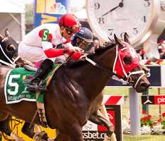 Ken and Sarah Ramsey's Sandbar took the lead from defending champion Happy My Way in mid-stretch and went on to a three-quarter length win in Friday's $150,000 Maryland Sprint Handicap (G3).