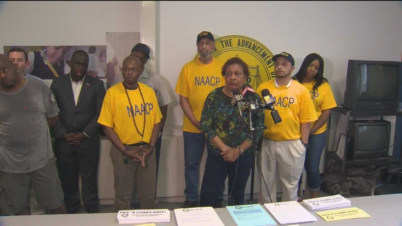 Community leaders address a recent spike in violence in Baltimore City and urge the public to stand up against crime.