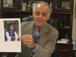 Baltimore International Academy Principal John Enkiriwith picture of Kester Browne III.