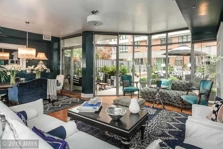 This beautiful bi-level condo with it's own professionally landscaped terrace & cabana is listed for $725K and includes three bedrooms, four bathrooms, and over 2,100 sq ft of living space. The home is featured on realtor.com.