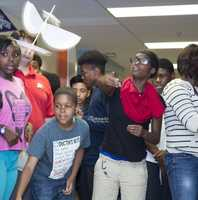 Students, teachers and parents participated in five science, technology, engineering and mathematics (STEM) challenges during the STEM Olympics at Woodlawn Middle School on June 3. One activity required students to build a glider -- powered by a rubber band -- that could travel four meters.