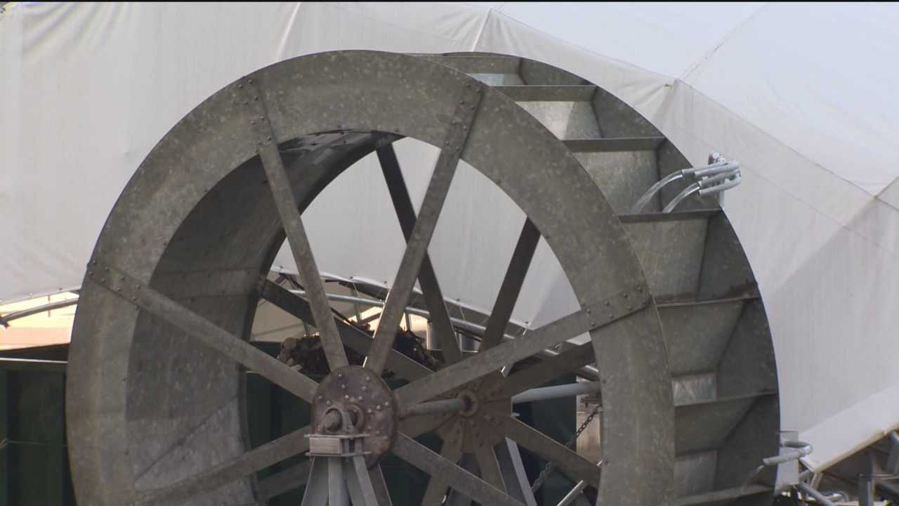 The water wheel cleans up trash in the harbor, but a second one is needed and so are the funds.
