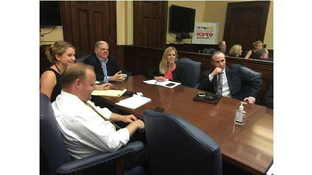 Gov. Larry Hogan meets with his staff on his first day back to work after receiving chemotherapy.