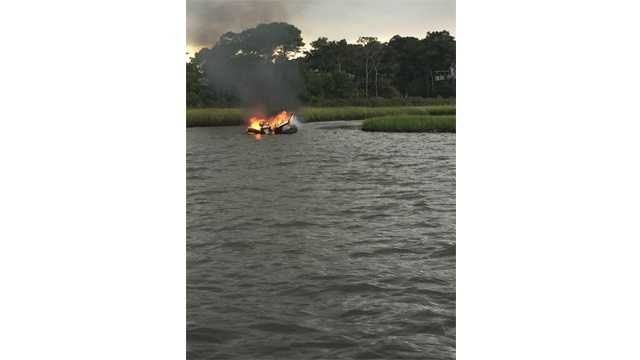 Seven people were rescued after a pontoon boat caught fire in the water canals near Ocean City.