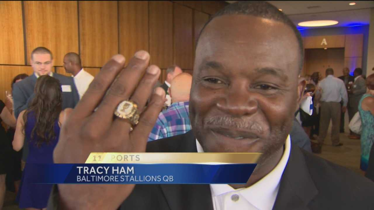 Baltimore Stallions quarterback Tracy Ham shows off his Grey Cup ring during a 20th anniversary reunion in Towson.
