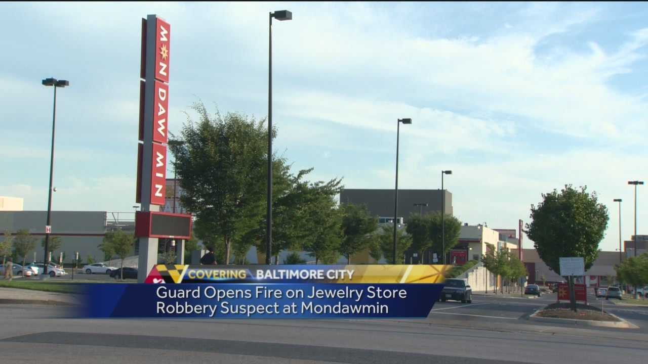 A security guard opened fire on a jewelry store robbery suspect Sunday at Mondawmin Mall.