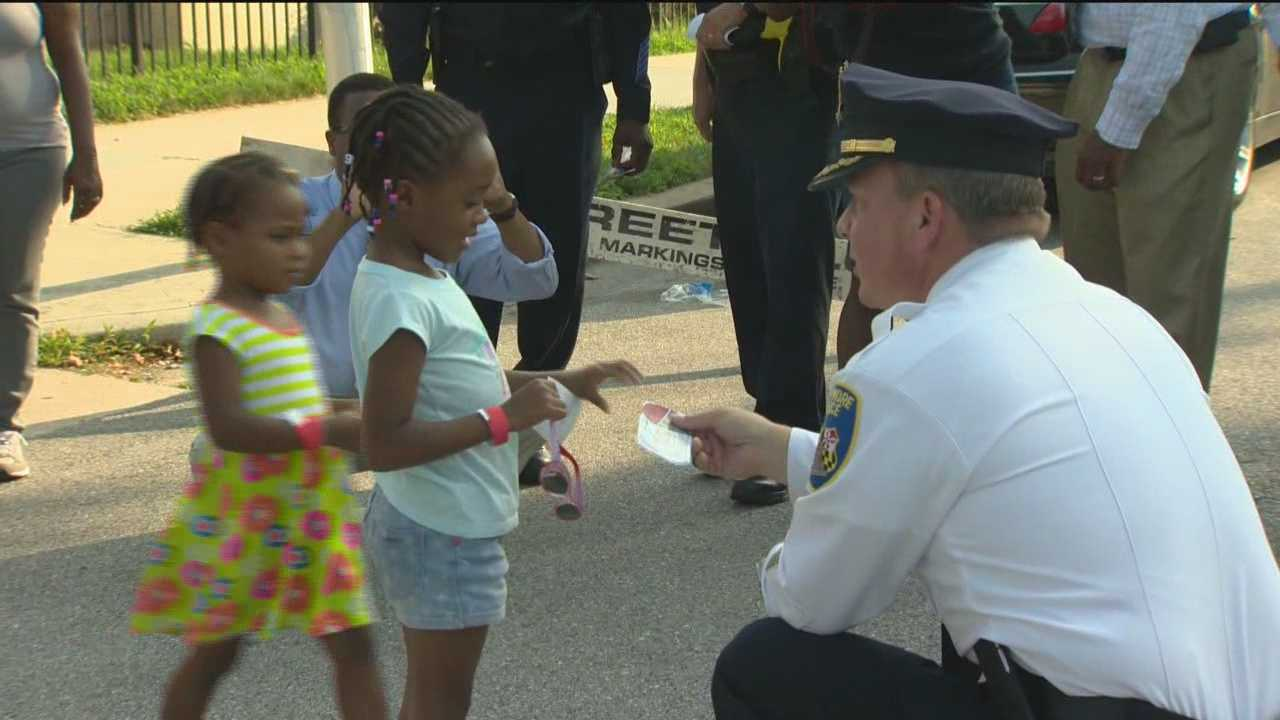 As violence continues to be a problem in Baltimore, city police and other leaders joined residents to celebrate National Night Out as a way to bring the community together.