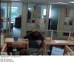 Maryland State Police release surveillance photos in connection with a bank robbery in Carroll County. Read the story for more details