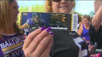 A Ravens fan shows off her ticket to the 2015 preseason home opener against the New Orleans Saints.