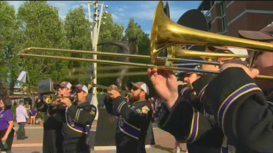 Members of the Ravens Marching Band greet fans as they prepare for the team's preseason opener against the New Orleans Saints.