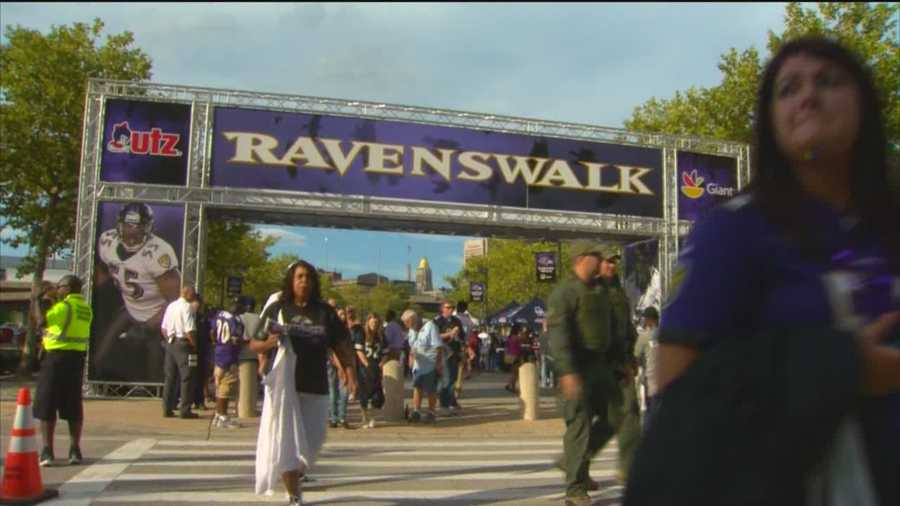 Ravens fans walk to M&T Bank Stadium prior to the 2015 preseason opener against the New Orleans Saints.