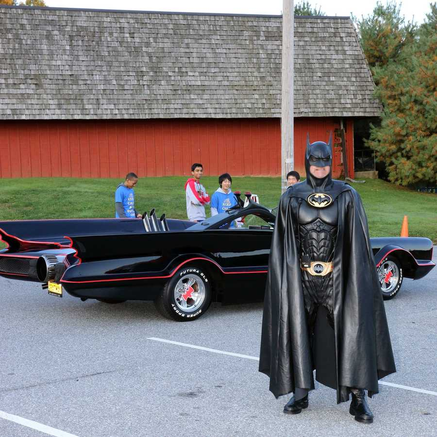 Len Robinson sold his cleaning business and used some of the funds to purchase an authentic Batman outfit and Batmobile which he used to visit sick kids in the hospital.
