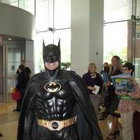 Len Robinson, dressed as Batman, visits sick children at Sinai Hospital.
