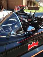 Len Robinson drives up to Sinai Hospital as Batman while driving in an authentic Batmobile.
