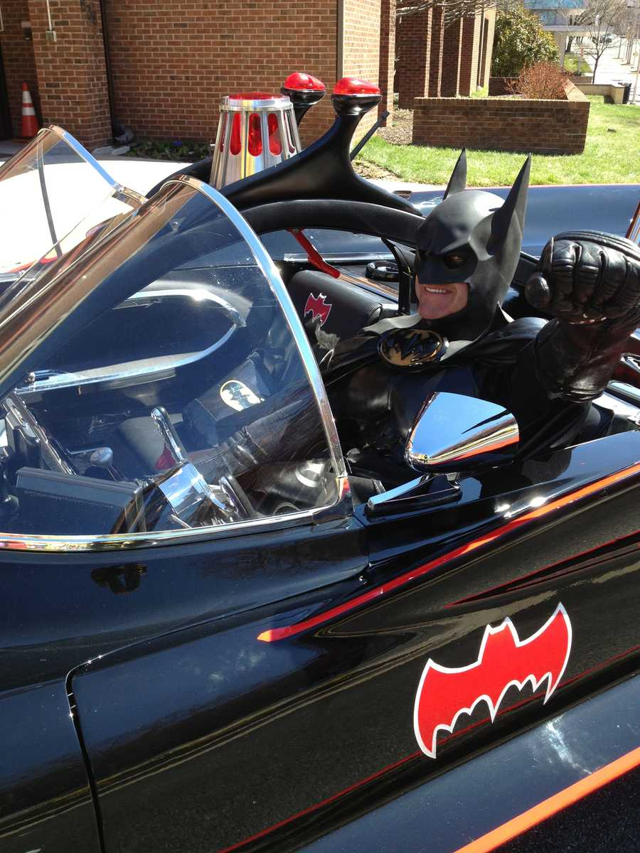 Len Robinson drives up to Sinai Hospital as Batman while driving in an authentic Batmobile.