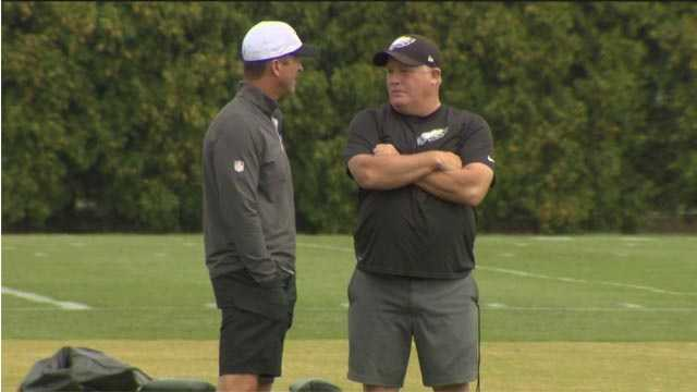 Ravens coach John Harbaugh and Eagles coach Chip Kelly talk during a recent practice involving both of their teams in Philadelphia.