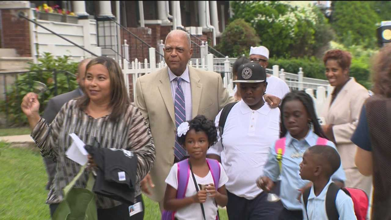 City schools CEO Dr. Gregory Thornton didn't wait for students to come Matthew Henson Elementary School Monday morning. He went to their homes to walk them to class.