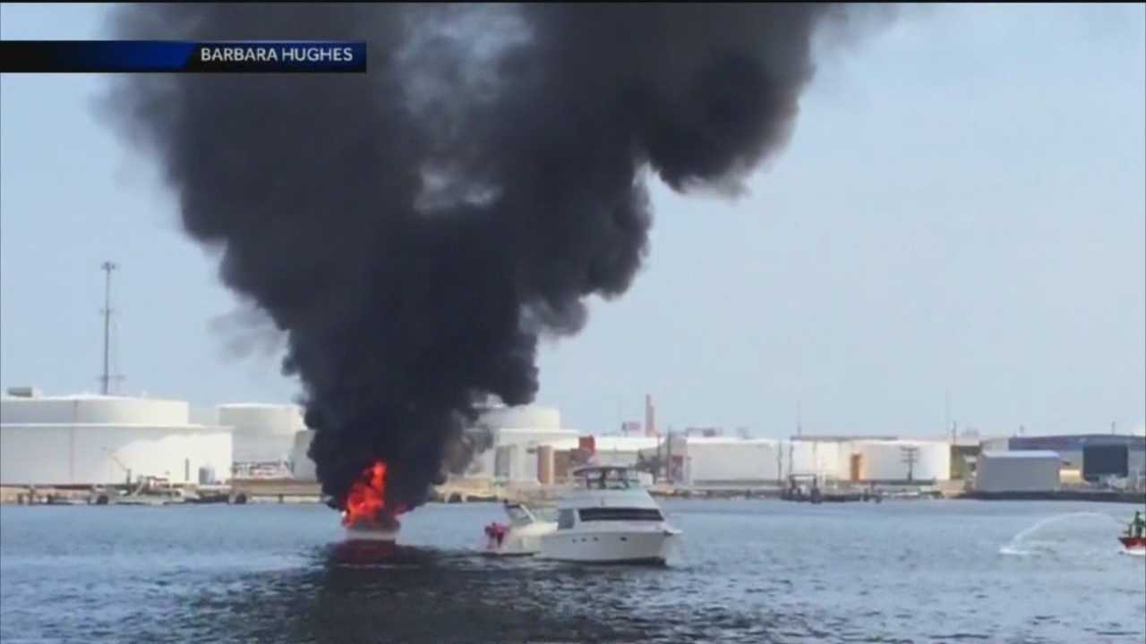 Bystanders help rescue a man from a 34-foot vessel engulfed in flames in Canton over the weekend.