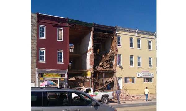 The Baltimore Office of Emergency Management said a building has collapsed.