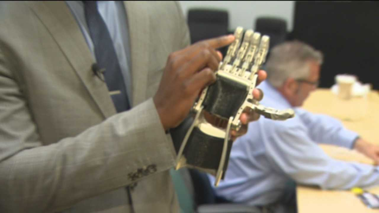 STEM students from two Baltimore high schools worked to make 3-D printed parts into functioning prosthetic hands for children around the world.
