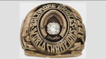 Brooks Robinson's World Series rings are among the items up for auction, the proceeds of which will go to charity.