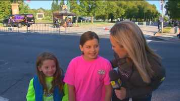WBAL-TV 11 News  Sarah Caldwell speaks to two Girl Scouts at Patterson Park during the 2015 Baltimore Running Festival.