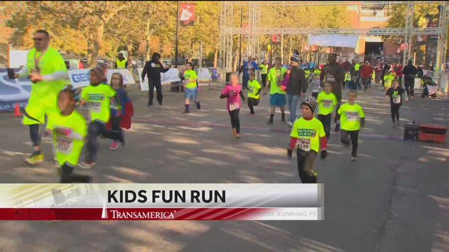 Hundreds of kids cross the finish line as part of the Baltimore Running Festival's Kids Fun Run.