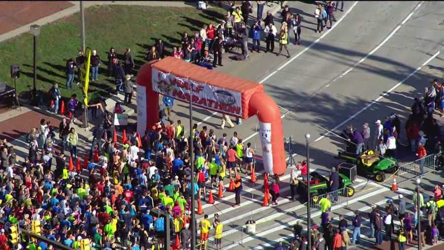 The first wave of runners prepare to start to the 2015 Baltimore Half Marathon.