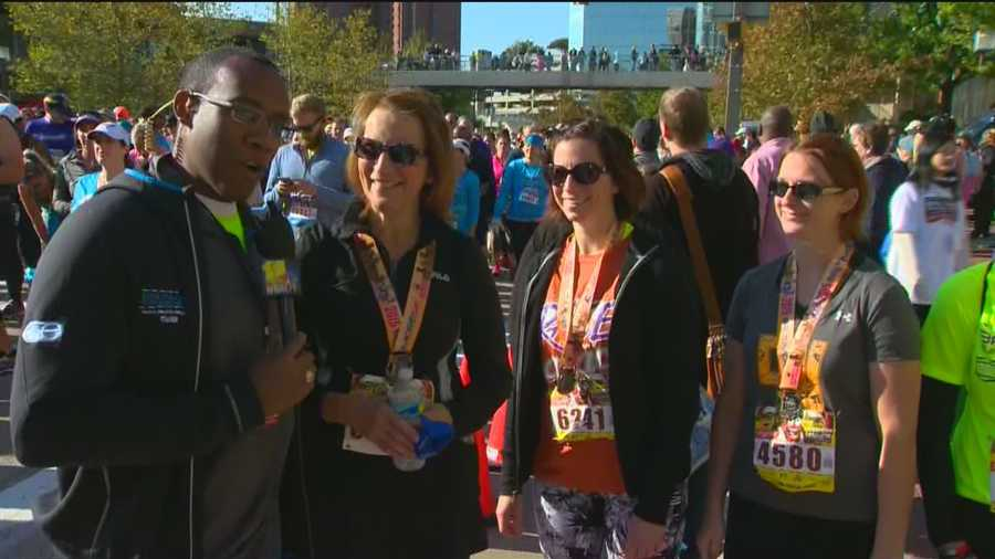 WBAL-TV 11 News' Jason Newston speaks to some of the finishers of the Baltimore Running Festival's 5K run