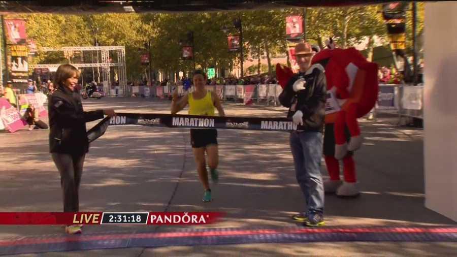 Dave Berdan crosses the finish line in the 2015 Baltimore Marathon.