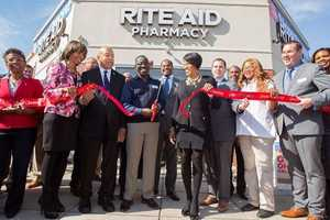 University of Maryland Pharmacy School Dean Eddington, Senator Catherine Pugh, Rep. Elijah Cummings, Rite Aid Store Manager Eugene Yamoah, City Councilman Nick Mosby, Baltimore Mayor Stephanie Rawlings-Blake, City Councilman Eric Costello, Rite Aid Pharmacist Elizabeth Atueyi and Rite Aid Executive Vice President Bryan Everett.